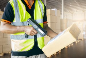 Warehouse worker is working with cargo in warehouse.